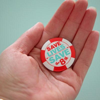 sr_badge-in-hand